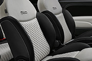 Dedicated black sand Matelassé fabric seats with techno leather details